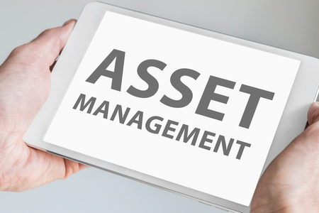 displayed: Asset management text Displayed on touchscreen of modern tablet or smart device. Stock Photo