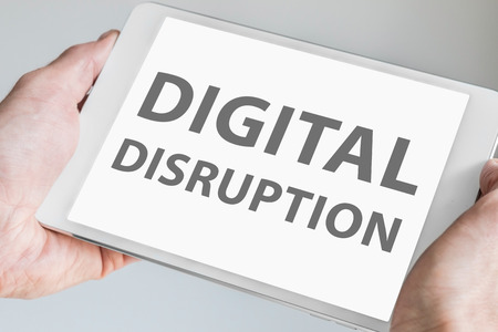 disruption: Digital disruption text Displayed on touchscreen of modern tablet or smart device.