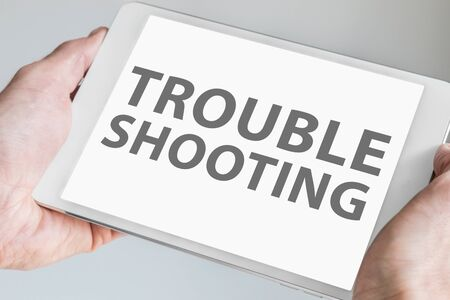 troubleshooting: Troubleshooting text Displayed on touchscreen of modern tablet or smart device. Stock Photo