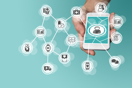 Digital and mobile healthcare concept with hand holding smart phone Foto de archivo