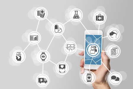 E-healthcare concept with hand holding smart phone. Stock Photo
