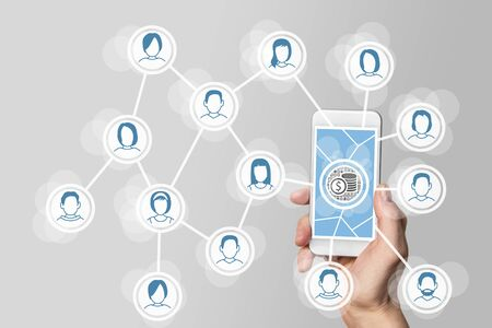 digitization: Monetization of social networks via viral and mobile marketing with hand holding smartphone