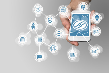 Block Chain concept with hand holding modern smart phone as example for fin-tech technology