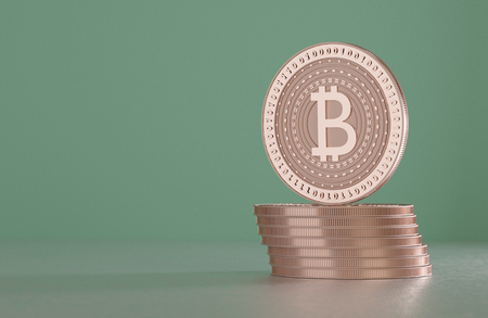 Stack of copper bitcoins as example for block chain technology in front of blurry background Stock Photo
