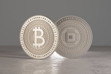 Silver bitcoins standing on metal floor with dramatic lighting as concept for virtual crypto currency