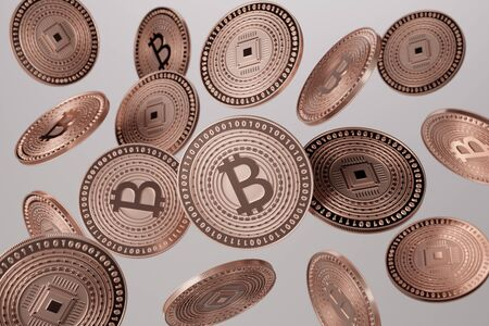 Close up of copper bitcoins tossed into the air as example for block chain and crypto-currency concept