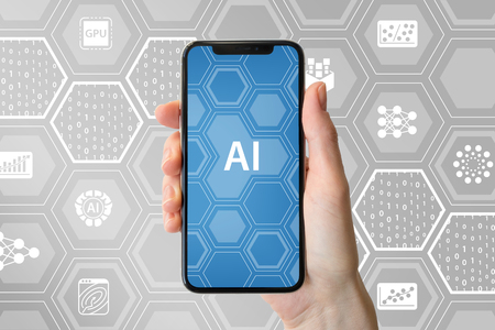 AI  artificial intelligence concept. Hand holding modern frameless smartphone in front of neutral background with icons Stock Photo