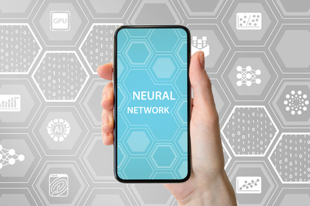 Deep neural network concept. Hand holding modern bezel free smart phone in front of neutral background with icons