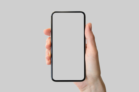 Hand holding bezel-free  frameless modern smartphone in front of neutral background