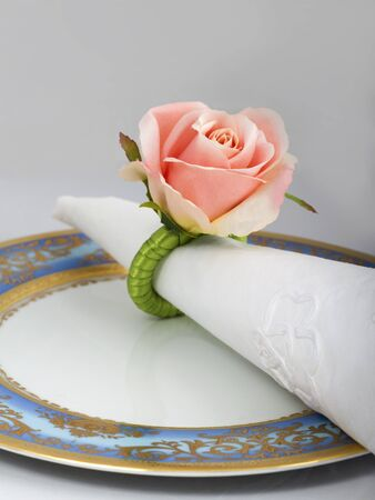 napkin ring: Pink rose napkin ring on blue and gold plate