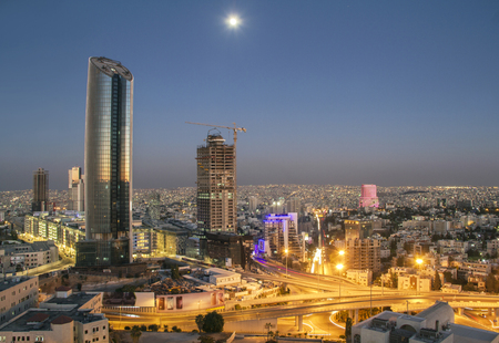Top view of the new downtown of Amman at night with moon 写真素材