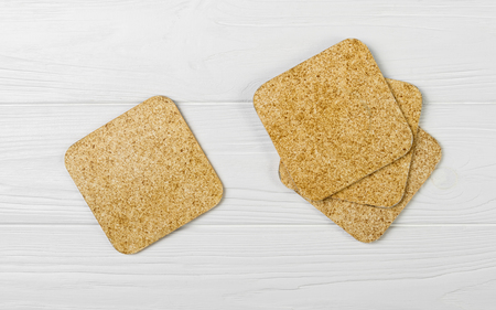 Cup coasters set on white wooden background