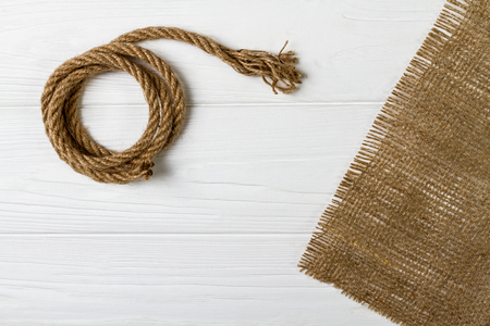 Rope and hessian fabric on wooden white table