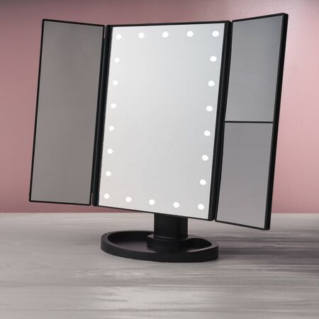 LED black vanity make up mirror on white wooden table and pink wall
