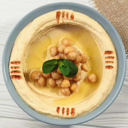 Top view of hummus plate on wooden table