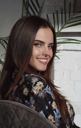 Portrait of pretty brunette girl with healthy white teeth smiling with natural makeup Stock fotó