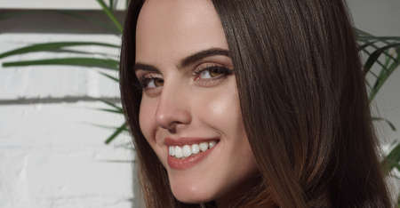 Close up on pretty girls face looking at the camera and smiling with natural make up and copy space Stock fotó