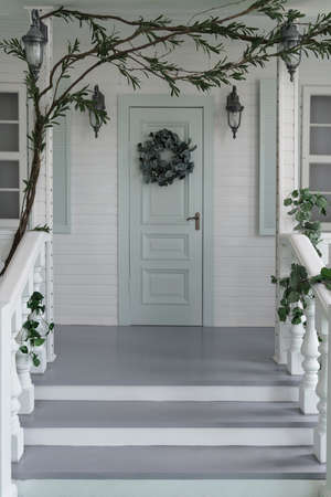 White Classic wooden house entrance stairs