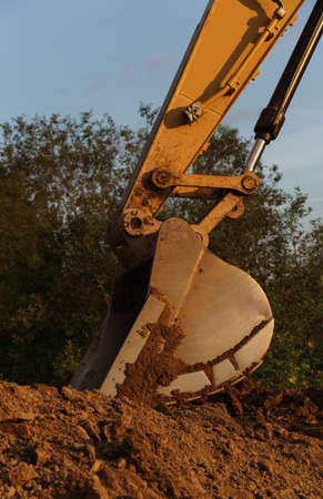 Side view of Excavator bucket on Construction site digging