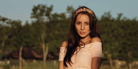 Portrait of a cute girl wearing off shoulder dress