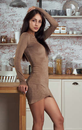 Sexy girl wearing tight dress and looking at the camera
