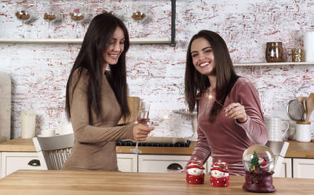 Two happy young women celebrating new year with sparklers Stock fotó