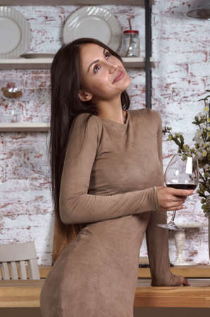Young woman feeling bored and drinking wine Stock fotó