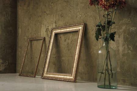 Two golden frames and flower vase Stock fotó