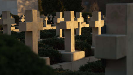 View of crosses on graves at sunset in Ukraine