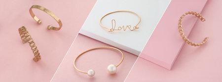 Modern golden bracelets on pink and white background