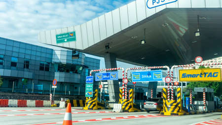 Selangor, Malaysia - November 28, 2019: The varoius type of vehicle road toll such as TouchNGo and Smart Tag at PLUS Highway near Serdang. Editorial