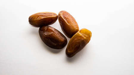 A pile of phoenix dactylifera, commonly known as dates or kurma on isolated white background.