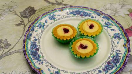 Mini blueberry cheese tart on a plate. Delicious dessert usually found during Eid Mubarak or Hari Raya celebration. Banco de Imagens