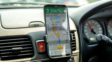 Bangi, Malaysia - July 28, 2019: Using Google Maps on smartphone to navigate the way to desired destination.