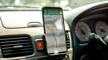 Bangi, Malaysia - July 28, 2019: Using Google Maps on smartphone to navigate the way to desired destination. Editorial
