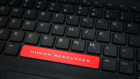 Close-up RESOURCES text on spacebar key button with red color on a black laptop keyboard background. Business conceptual photo. Selective focus.