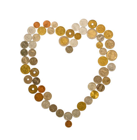 International cash including European, Hongkong, Malaysia, and Thai money, they are golden, silver and bronze coins collocate in a heart shape isolated on white background