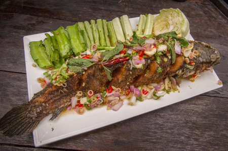 chilli sauce: Fried fish toppted with chilli sauce