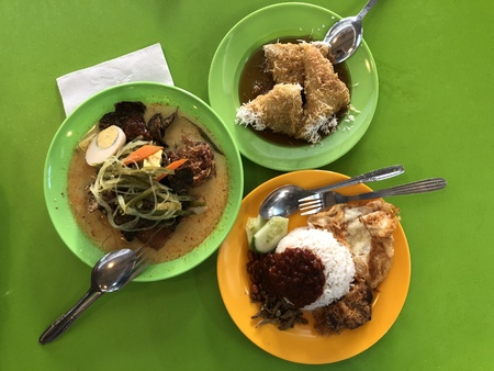 Nasi lemak and lontong served as breakfast in Malaysia