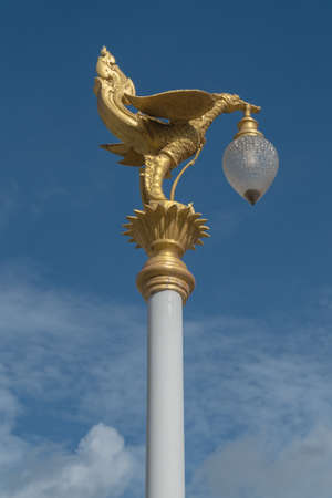 golden swan statue on a top lamp pole,sky blackground Stock Photo