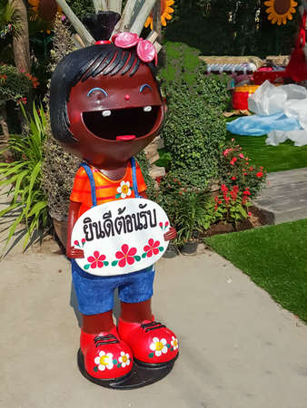 close up,Happy dolls for garden decoration have greeting in Thai means thatwelcome
