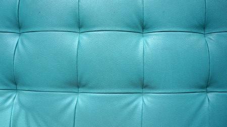 blue leather sofa: Struttura del primo piano di divano in pelle blu d'epoca per lo sfondo
