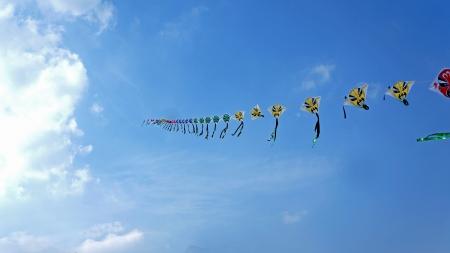 paper kites: Red faces on paper kites