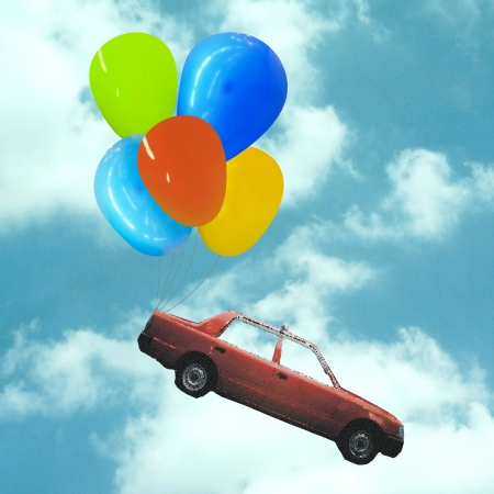 Car with ball0ons over sky photo