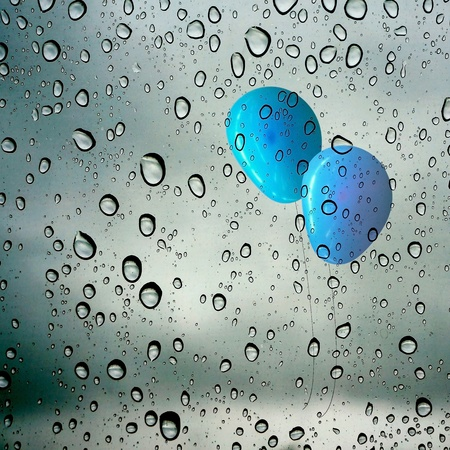 drop waters on glass with balloons outside photo