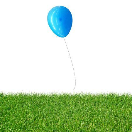 green grass with floating blue balloon photo