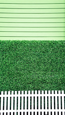 Green wall with white fence background photo