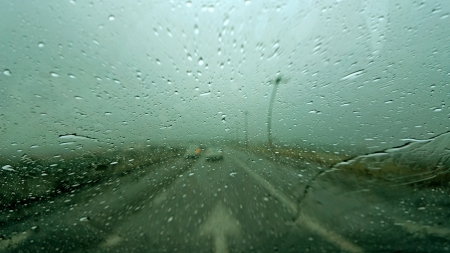 Driving in rain with street arrow sign Stockfoto
