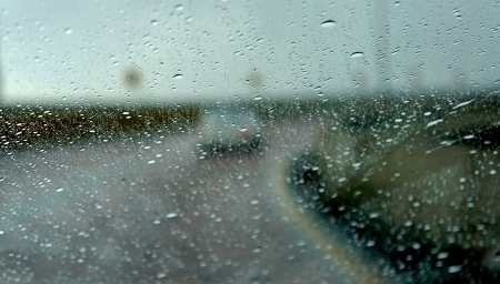 Driving in rain with road curve as background photo