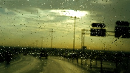 Rain on car front window photo